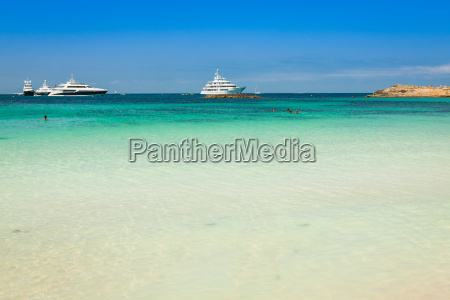 luxury yachts in turquoise beach of