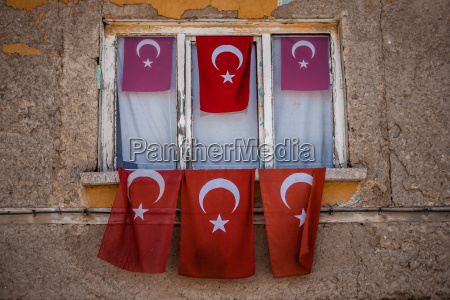old house with turkish flags