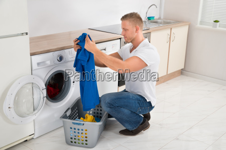 man with t shirt while using