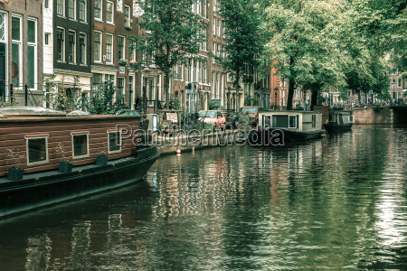 amsterdam canal with boats holland netherlands