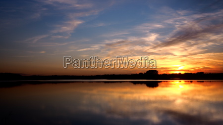 a beautiful sunset on the water
