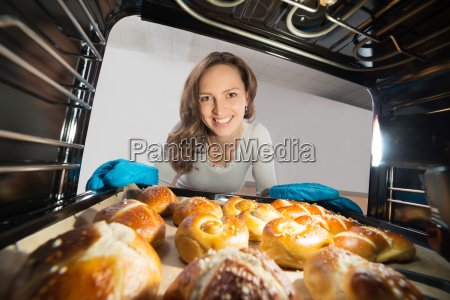 woman removing bun view from inside