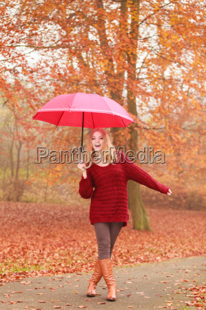fashion woman with umbrella relaxing in
