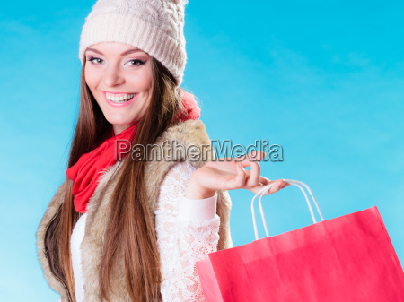 winter woman with red paper shopping