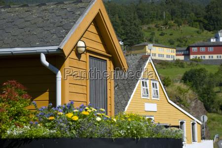 yellow scandinavian wooden houses in norway