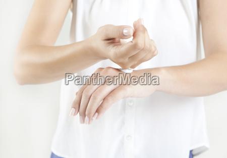 woman hand cream