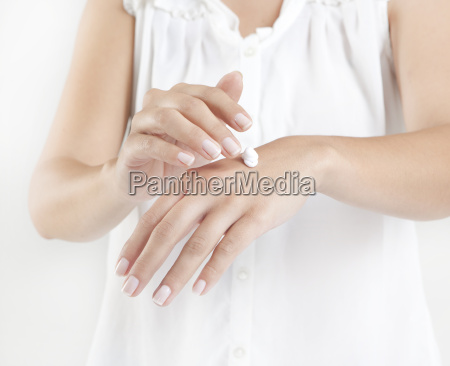 hands with hand cream