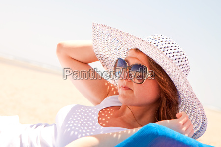 woman in a hat on the