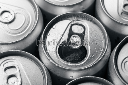 soda cans with one opened