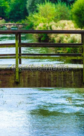 old small bridge over river in