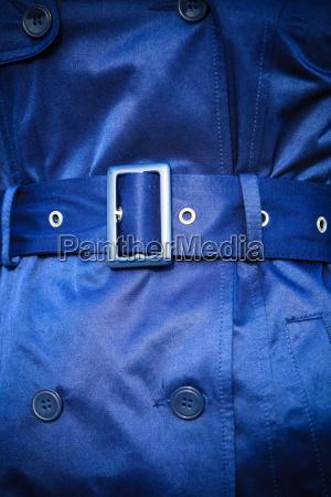 female fashion closeup blue coat wit