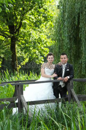 bride and groom posing in nature