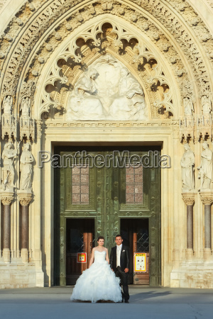 bride and groom standing in front