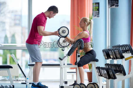 young sporty woman with trainer exercise
