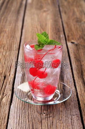 iced drink with maraschino cherries
