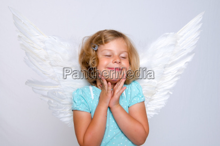 little blond girl with angel wings