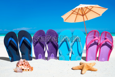 colorful flip flops in a row