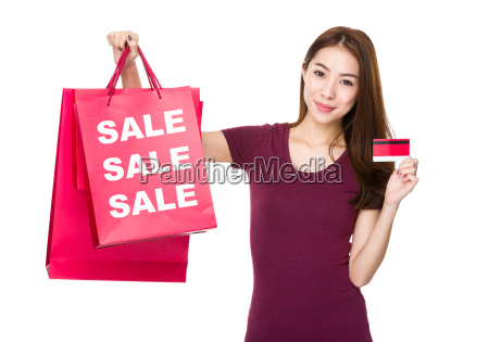 woman hold shopping bag and credit
