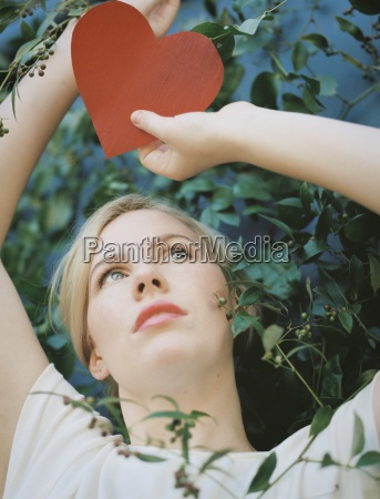 a blonde woman holding a red