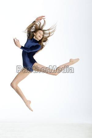 gymnast posing in midair