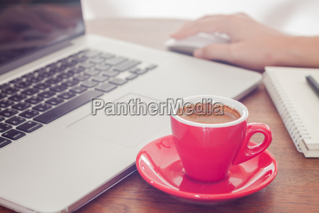 red coffee cup with notepad and