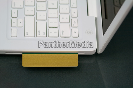 credit, card, in, white, laptop - 14713567