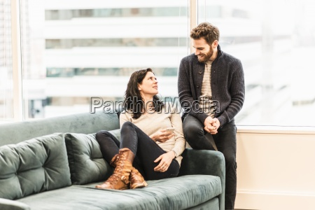 two people a woman sitting on