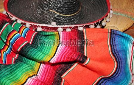mexican sombrero fiesta poncho serape background
