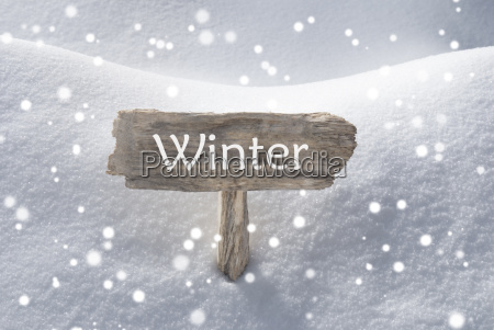 christmas sign snow and snowflakes winter