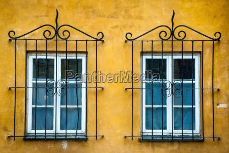 two windows with ornamental metal lattice