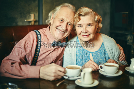 happy seniors in cafe