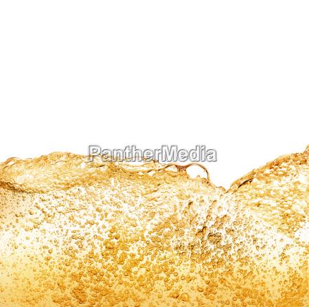 golden drink bubbles against white background