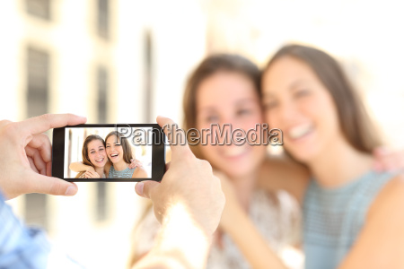 friends taking photos with a smart