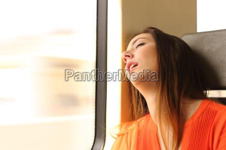 traveler sleeping in a train travel