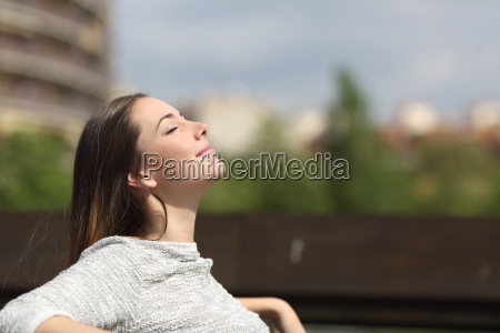 urban woman breathing deep fresh air