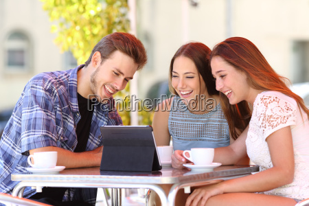 three friends watching tv or social