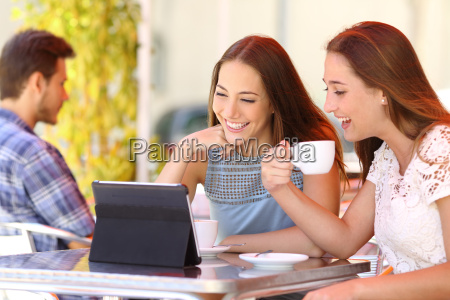 two friends or sisters watching videos