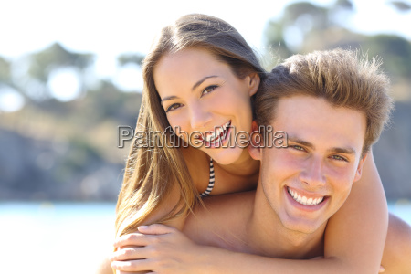 couple with perfect smile posing on