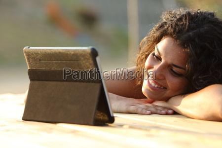 woman watching videos on a tablet