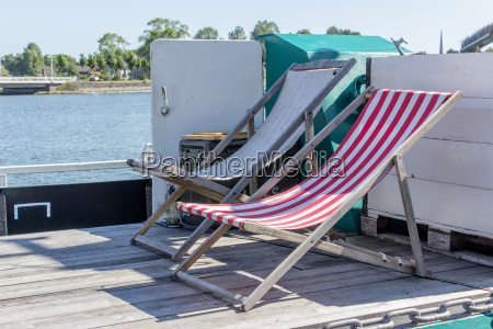 two deck chairs on the ships