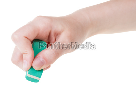hand with green new rubber eraser