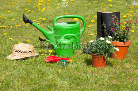 garden tools and straw hat on