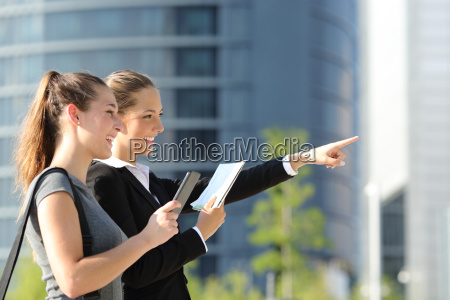 businesswomen searching location with mobile gps