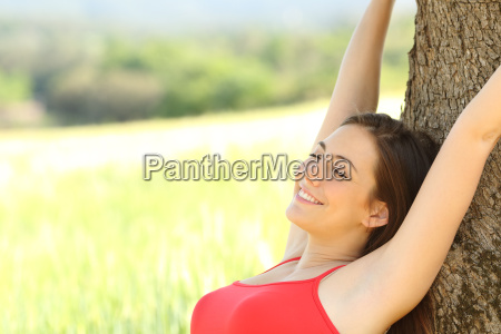 happy woman resting in the country