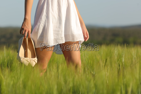 relaxed woman legs walking in a