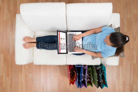 woman browsing shopping site on laptop