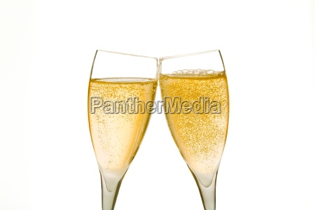 cheers two champagne glasses with gold