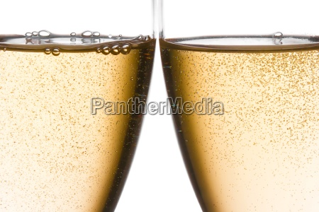 detail of cheers with two champagne