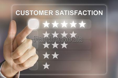 business hand pushing customer satisfaction on