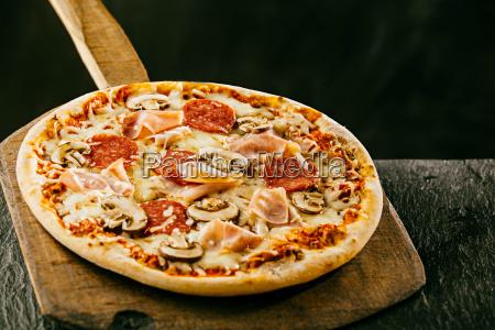 freshly baked italian pizza with ham